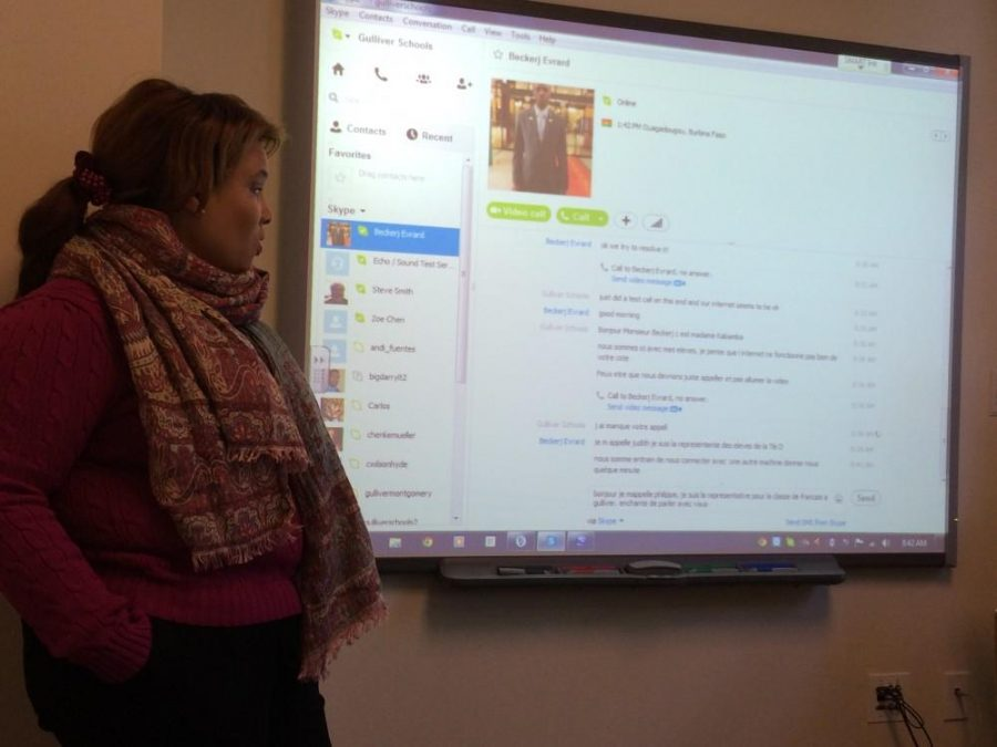 Madame Kabamba discusses the goal of the Skype call with students prior to calling in.  Photo by Bianca Corgan.