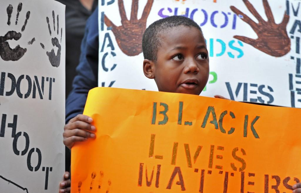Jan/05/2015 10:14 AMMOMS-BLACK-STUDENTS-PUNISHED-MORE-AT  Download | Preview in New Window Moms 3000 x 1932 Color JPEG Related media: Text Marquise Miller, 8, who came with his mother, holds a sign outside Marietta Municipal Court during their peaceful demonstration against decisions not to indict white police officers in the deaths of unarmed black men in Ferguson, Mo., and in New York City on Saturday, Dec. 6, 2014 in Marietta, Ga. (Hyosub Shin/Atlanta Journal-Constitution/TNS)