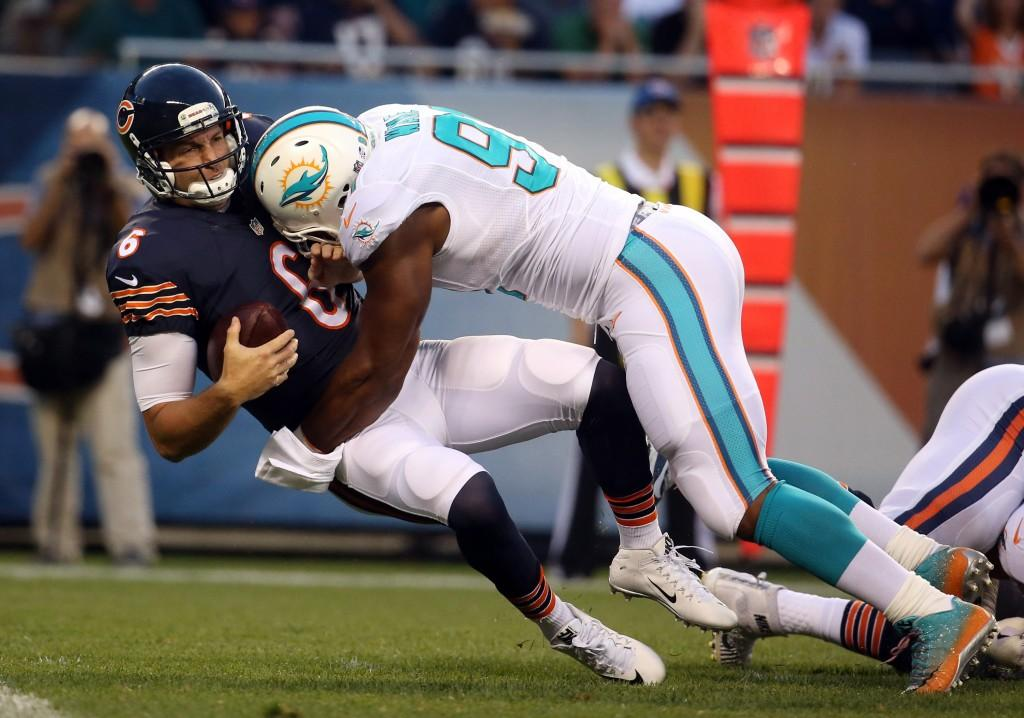 Miami Dolphins defensive end Cameron Wake (91) sacks Chicago Bears quarterback Jay Cutler, overturned on a penalty, in the second quarter on Thursday, Aug. 13, 2015 at Soldier Field in Chicago. (Brian Cassella/Chicago Tribune/TNS)