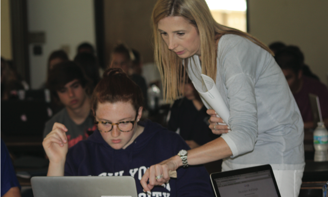 Guidance counselor Yasmin McGinnis helps senior Marley Glassberg navigate through the Common App website. As part of the Senior Boot Camp, seniors also linked their profiles on Naviance. Photo by Kayla Patel.