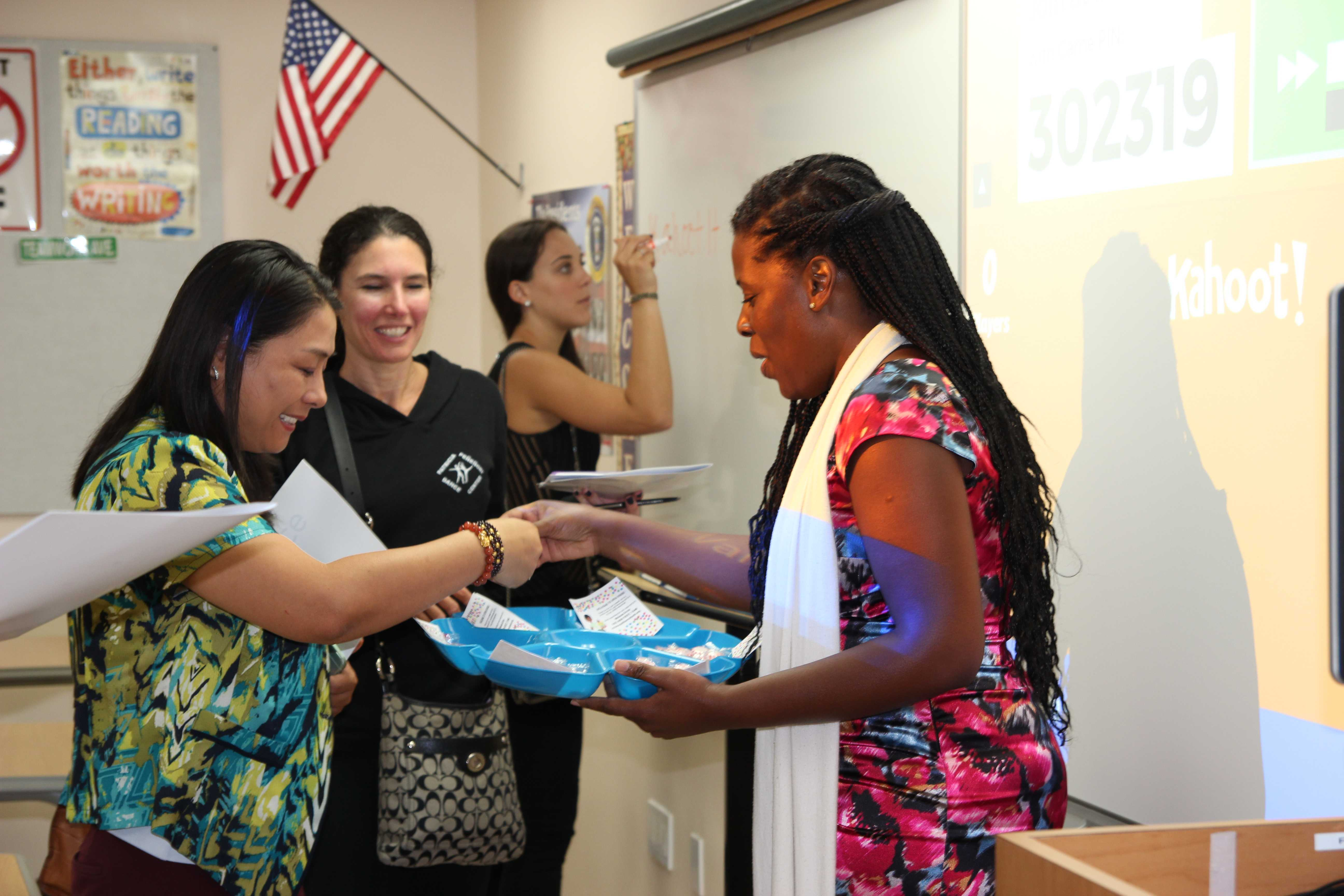 Parents Interact with Teachers at Back to School Night
