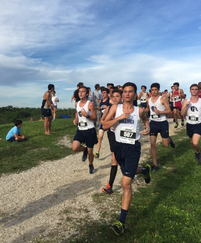 Several cross country run- ners, finish the latter part of the race. The runners include juniors Ryan Pino.