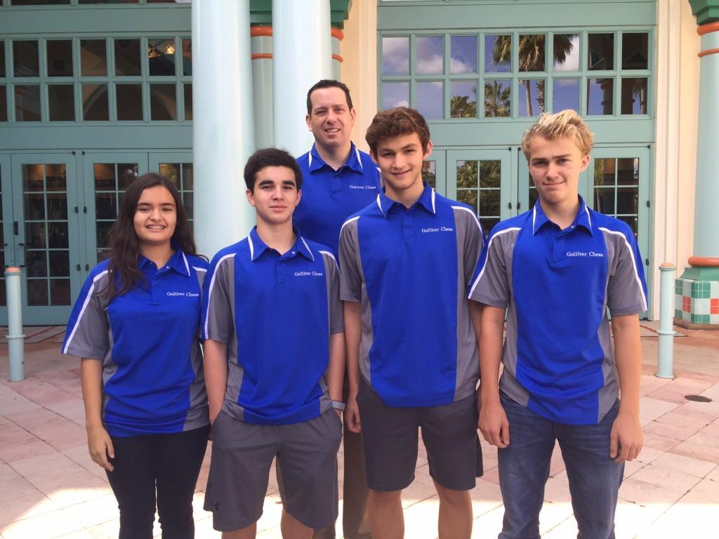 Sophomores Zachary Ashbel, Megan Garcia, Philip Gubbins, Brandon Stoyanovich stand with their coach Mr. Randall Smith.