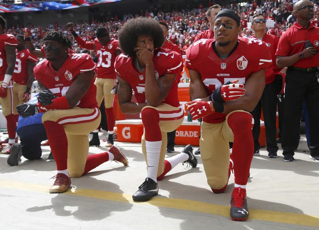 From+left%2C+the+San+Francisco+49ers%27+Eli+Harold%2C+Colin+Kaepernick+and+Eric+Reid+kneel+during+the+national+anthem+before+their+NFL+game+against+the+Dallas+Cowboys+on+October+2%2C+2016%2C+at+Levi%27s+Stadium+in+Santa+Clara%2C+Calif.+%28Nhat+V.+Meyer%2FBay+Area+News+Group%2FTNS