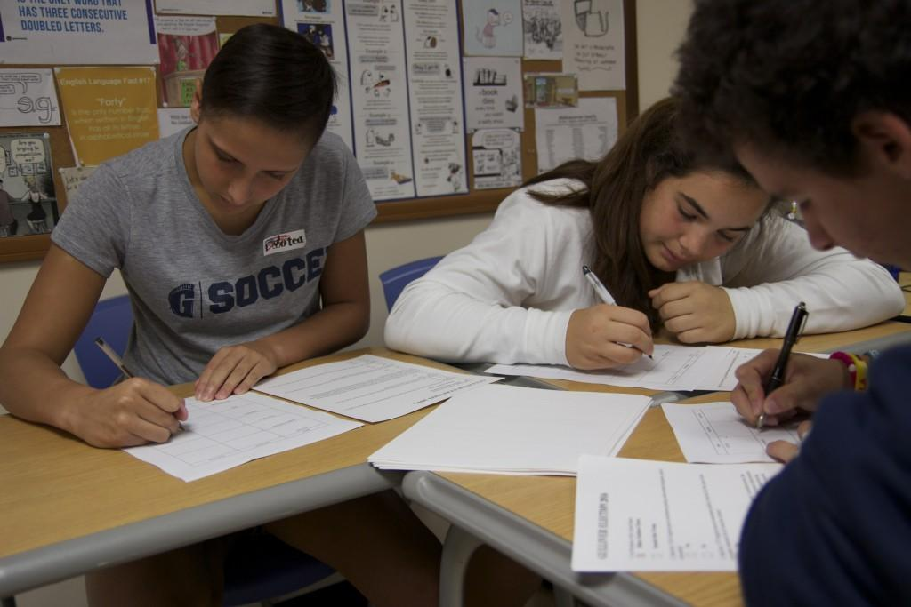Students carefully tallied the ballots at the polling station set up in Mr. Gabriel Medinas classroom.  Polling stations were set up throughout the social science department, so that all students had an opportunity to take part in the election.  Photo by Shannon Kunkel