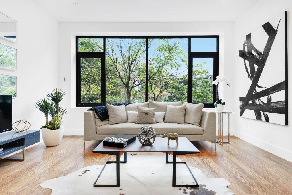 A modern living room is fresh and bright with help from the use of greenery. (Handout/TNS)