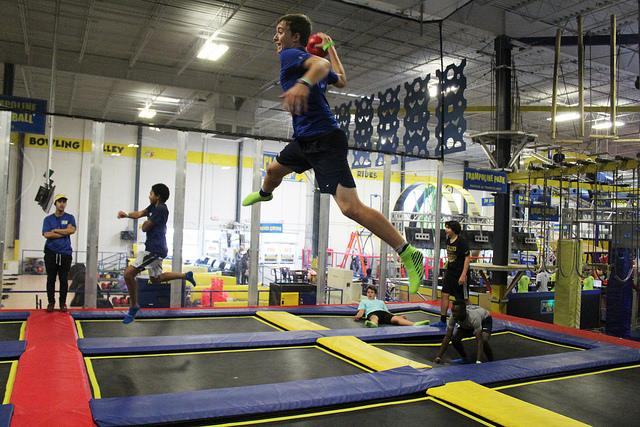 Freshman William Bettridge jumps for slam dunk at Planet Air's trampoline park in Doral. Bettridge was one of over 200 freshman that participated in an all-day, team-building class event.  Photo by Communications Specialist Maegan Azpiazu.