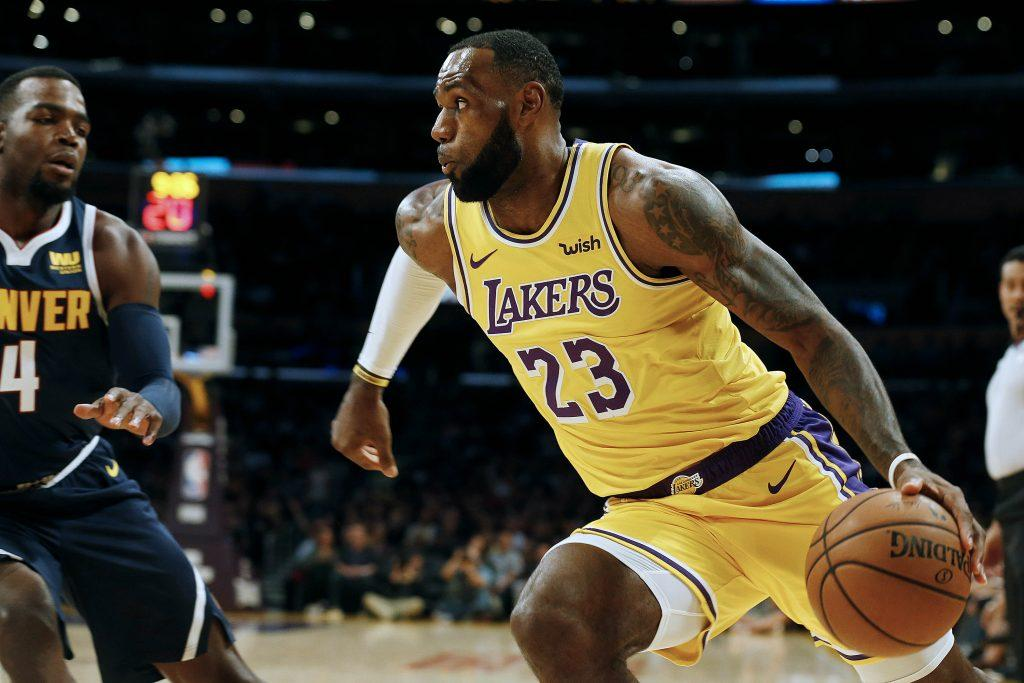 Los Angeles Lakers forward LeBron James (23) is defended by Denver Nuggets forward Paul Millsap (4) in the first half on Tuesday, Oct. 2, 2018 at the Staples Center in Los Angeles, Calif. (Gary Coronado/Los Angeles Times/TNS)