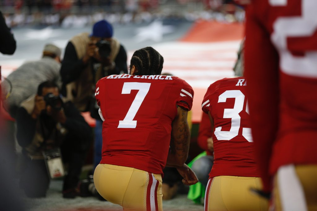 San Francisco 49ers quarterback Colin Kaepernick (7) kneels during the National Anthem before the game against the Los Angeles Rams on Monday, Sept. 12, 2016 at Levi's Stadium in Santa Clara, Calif. (Nhat V. Meyer/Bay Area News Group/TNS)