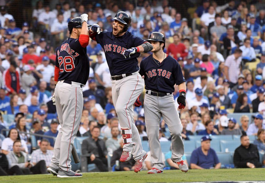 Boston Red Sox's Steve Pearce, center, celebrates his two-run home run against the Los Angeles Dodgers in the first inning in Game 5 of the World Series on Sunday, Oct. 28, 2018 at Dodger Stadium in Los Angeles, Calif. (Wally Skalij/Los Angeles Times/TNS)