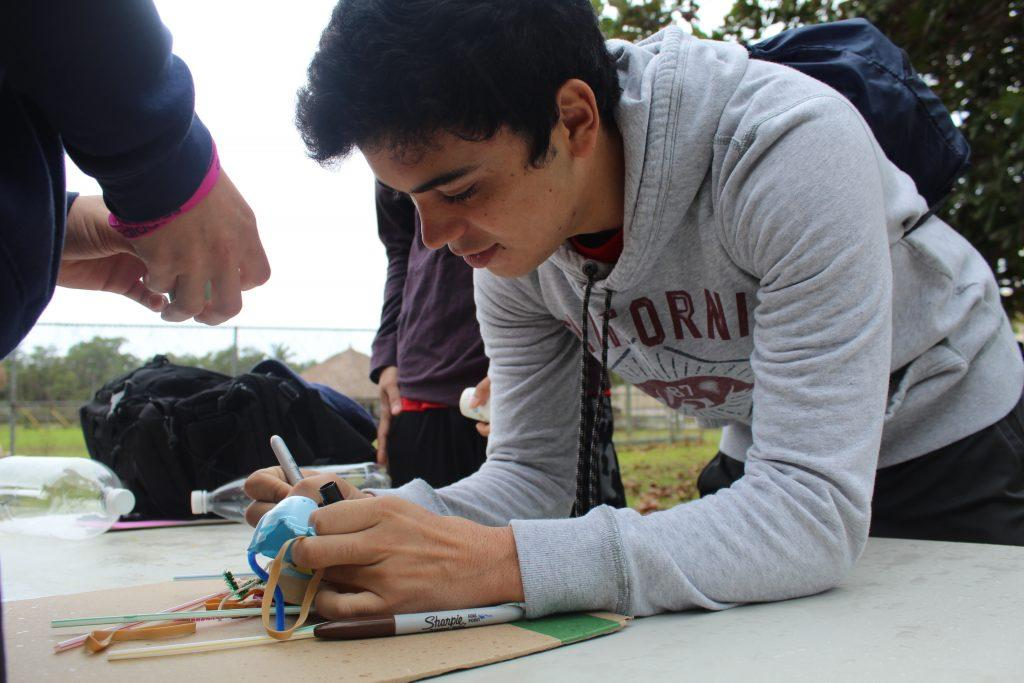 Between climbing a ropes course, kayaking, and building handcrafted rockets, Seniors had an exciting time on a hectic day. Photos by Vanessa Rosales