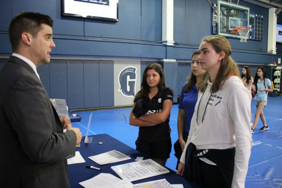 Students+speak+with+financial+advisor+Joe+Traba+during+the+Career+Fair+on+Feb.+6.++Traba+spoke+to+them+about+financial+advising+and+wealth+management+careers.++The+Fair+featured+booths+in+many+business+and+career+areas%2C+including+architecture%2C+communications+and+entrepreneurship.++Photo+by+Cindy+Vega.+