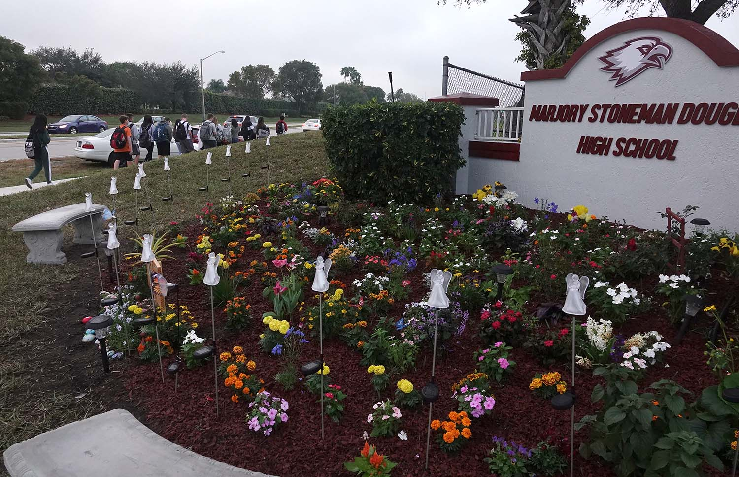 Students walk past the new memorial garden outside of Marjory Stoneman Douglas High School in Parkland, Fla., Monday, Jan. 14, 2019.  (Joe Cavaretta/South Florida Sun Sentinel/TNS)