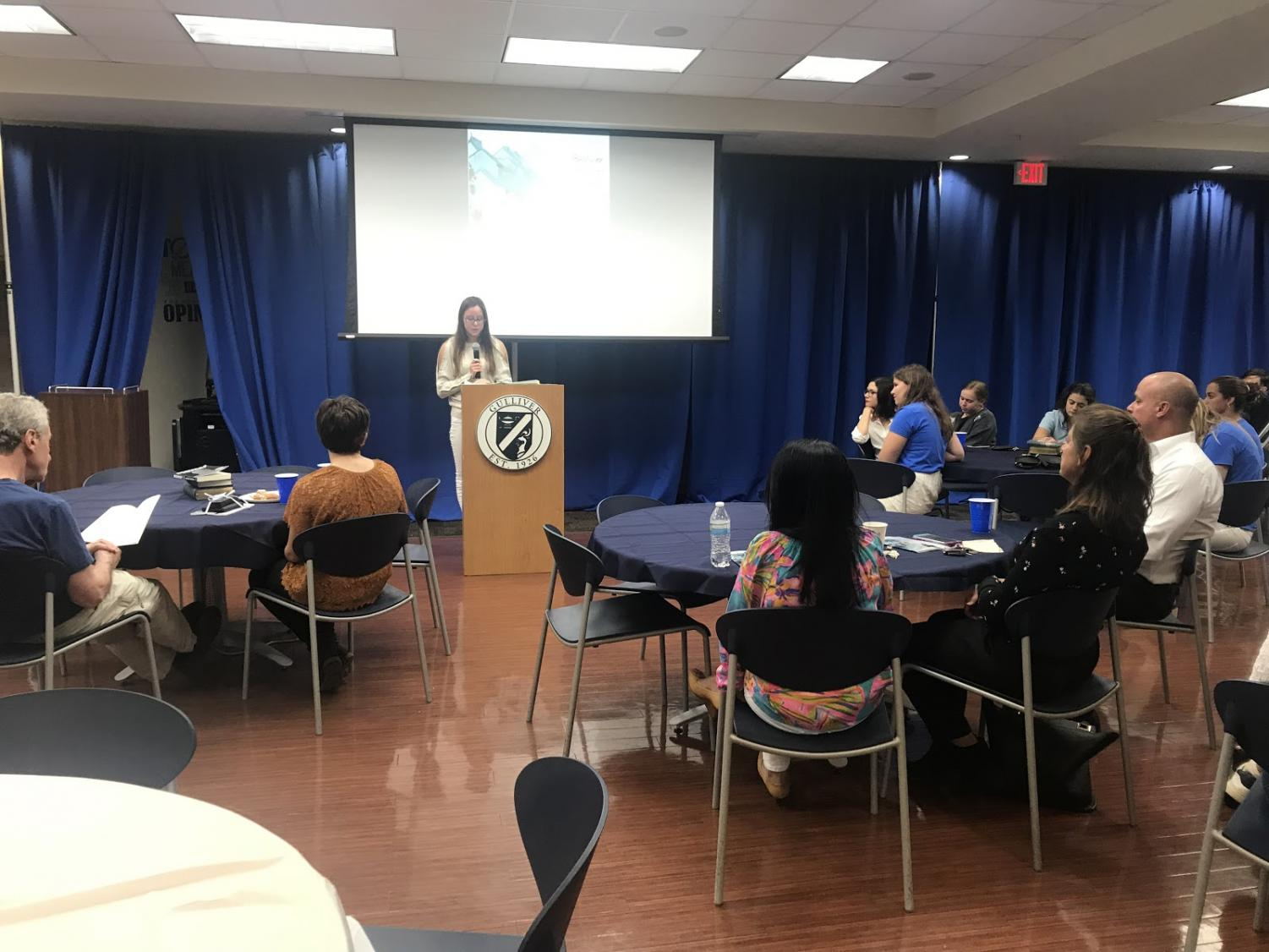 Senior Olivia Hernandez reads an excerpt from her most recent novel at Gulliver Writes. The NEHS board selected a wide variety of student-written pieces to feature. The event took place in the student union on Apr. 10. Photo by Lara Russell-Lasalandra