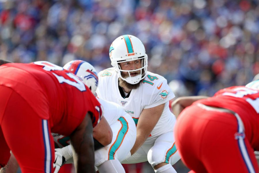 Ryan Fitzpatrick #14 of the Miami Dolphins looks to his left during the third quarter of an NFL game against the Buffalo Bills at New Era Field on October 20, 2019 in Orchard Park, New York. (Bryan M. Bennett/Getty Images/TNS)