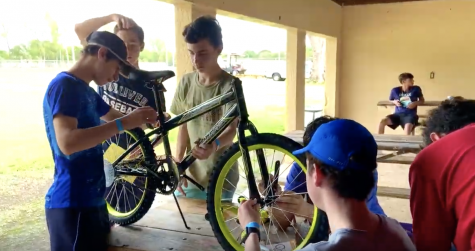 Video: Sophomores work together to build bikes for charity at their annual team-building event