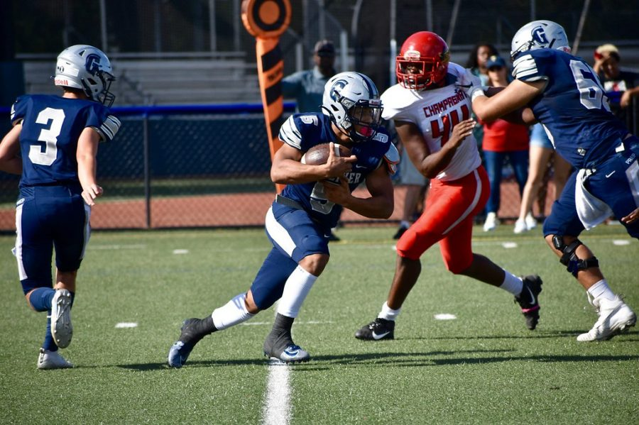 Senior, Gabriel Taylor, returns the punt all the way for a touchdown. Photo by Jen Uccelli.