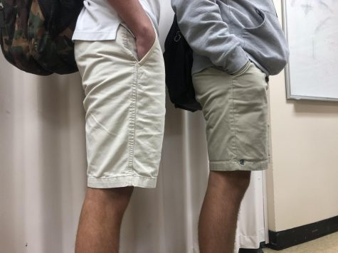 "Students stand side by side wearing variations of ""uniform pants."" These two boys demonstrate the differences between what many others wear to school and the traditional AA pants."