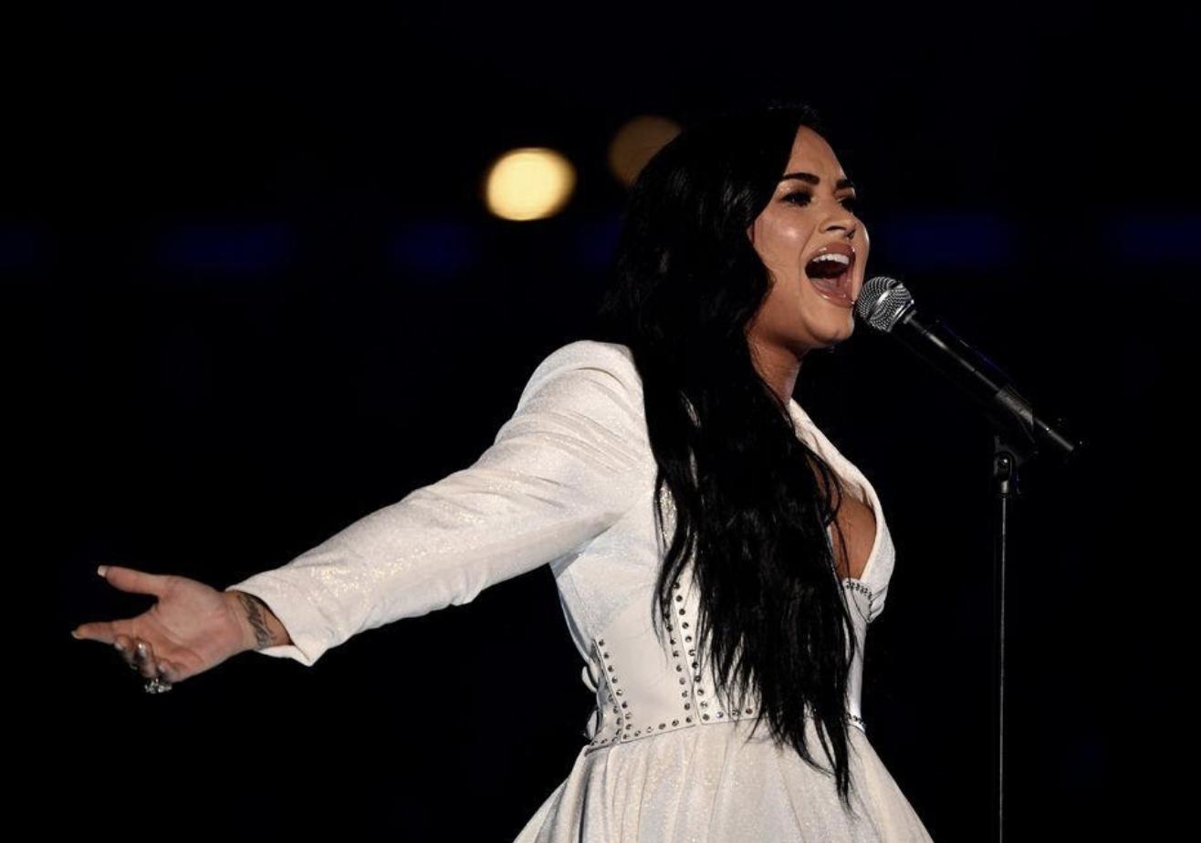A visibly moved Demi Lovato belts