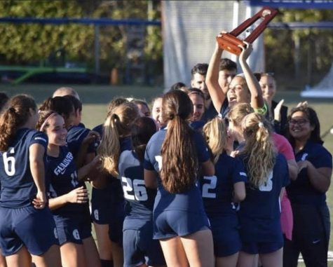 The girls varsity soccer team celebrates after winning a district championship on Wednesday. The team fought hard to defeat Mast Academy 3-0, and will move onto the regional tournament next week. Photo by David Hartnett.