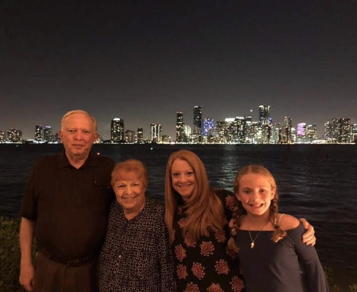 My grandfather (far left) and I (far right) in Miami Beach in 2019.