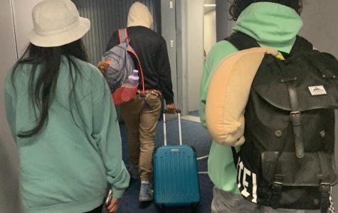 Passengers board a plane in LA, California over the summer.