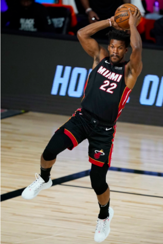 Jimmy Butler (22) of the Miami Heat passes against the Indiana Pacers during the second half of a first round playoff game on August 24, 2020 at The Field House at ESPN Wide World Of Sports Complex in Lake Buena Vista, Florida.