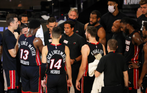 Erik Spoelstra of the Miami Heat talks with his team during the fourth quarter against the Milwaukee Bucks in Game Five of the Eastern Conference Second Round during the 2020 NBA Playoffs at The Field House at the ESPN Wide World Of Sports Complex on Tuesday, September 8, 2020 in Lake Buena Vista, Florida.