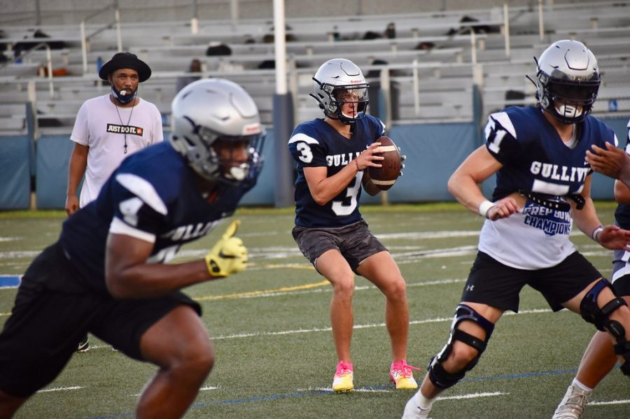 The varsity football team practices on Sept. 18. Football players are now resuming training as usual, but along with other contact athletes, they must attend school online.