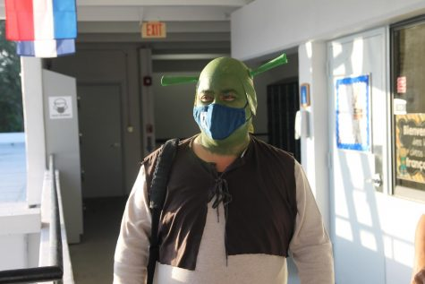 """As is the tradition, math teachers teamed up for a group Halloween costume. Math teacher Christopher Kang took the lead role for this year""""s """"Shrek"""" theme."""