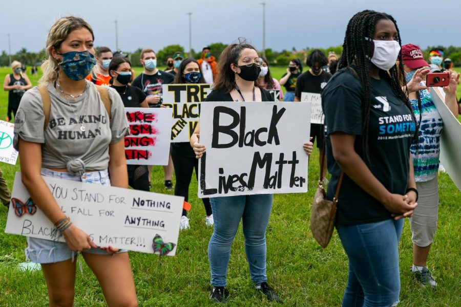 Activists listen to speakers during a Black Lives Matter rally at Pine Trails Park in Parkland, Florida on Saturday, July 11, 2020.