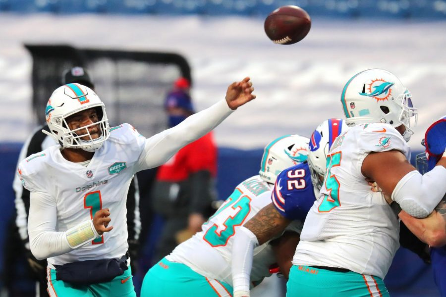 Tua Tagovailoa #1 of the Miami Dolphins makes a pass against the Buffalo Bills in the fourth quarter at Bills Stadium on Jan. 3, 2021 in Orchard Park, New York.