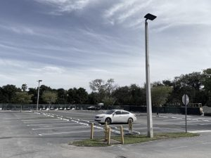 The student parking lot sits empty, as all juniors and seniors must quarantine and attend class remotely for the next two weeks.