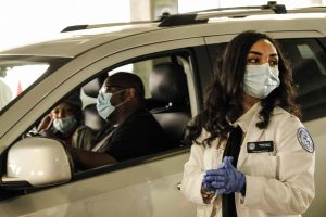 A medical worker prepares to administer a flu vaccination at a drive-through clinic held by Meijer at Comerica Park in Detroit on November 10, 2020.