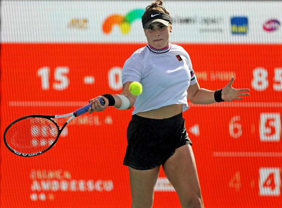 Bianca Andreescu of Canada returns a shot against Irina-Camelia Begu of Romania during their match at Miami Open tennis tournament on Thursday, March 21, 2019 at Hard Rock Stadium in Miami Gardens, Fla.