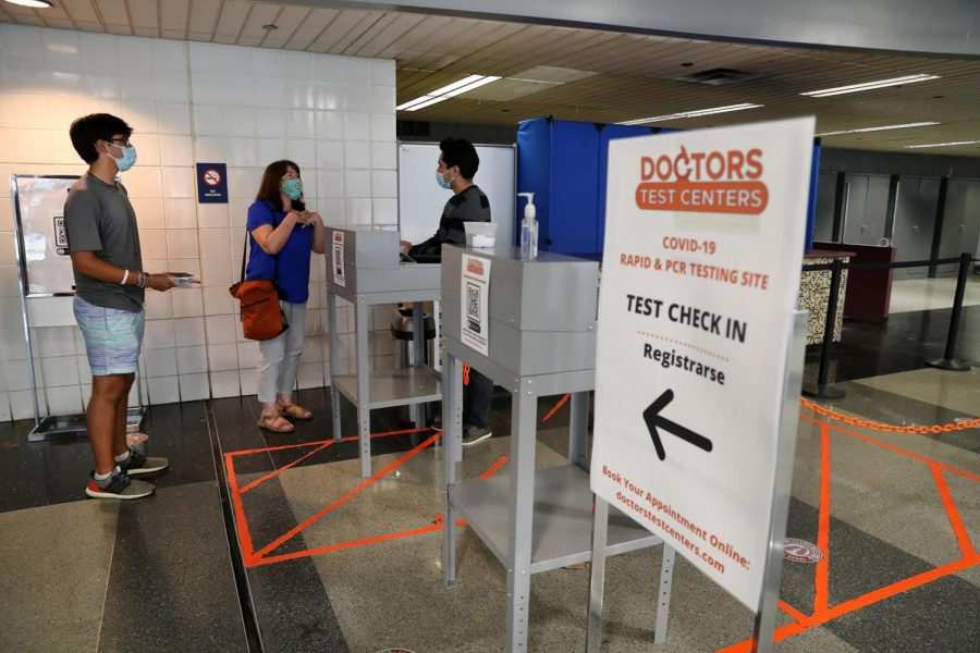 Anne-Laure Mostacero and her son, Timothee, 19, are checked in for their Covid-19 tests at Doctors Test Centers at Chicagos OHare International Airport on Thursday, May 20, 2021. The family was getting tested a day prior to their flight to Spain. They are moving from Deerfield to Barcelona.