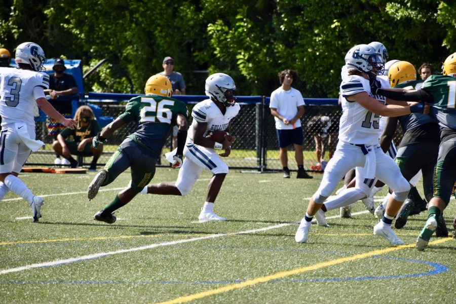 Junior+running+back+Sedrick+Irvin+takes+a+handoff+from+senior+quarternback+Carson+Haggard.+The+Raiders+take+on+their+next+opponent%2C+Palmetto%2C+today+at+4+pm+at+home.