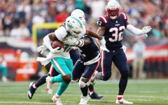 Jaylen Waddle (17) of the Miami Dolphins runs with the ball after a reception against the New England Patriots at Gillette Stadium on September 12, 2021 in Foxborough, Massachusetts.