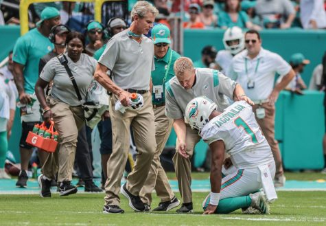 Miami Dolphins quarterback Tua Tagovailoa (1) drops to his knees after getting injured in the first quarter during a game against the Buffalo Bills in Miami Gardens on Sunday, September 19, 2021.