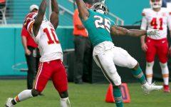 Miami Dolphins cornerback Xavien Howard (25) intercepts a ball intended for Kansas City Chiefs' Tyreek Hill (10) during the second half on Sunday, Dec. 13, 2020 at Hard Rock Stadium in Miami Gardens, Florida.