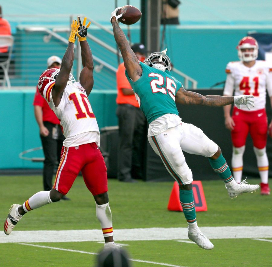 Miami Dolphins cornerback Xavien Howard (25) intercepts a ball intended for Kansas City Chiefs Tyreek Hill (10) during the second half on Sunday, Dec. 13, 2020 at Hard Rock Stadium in Miami Gardens, Florida.
