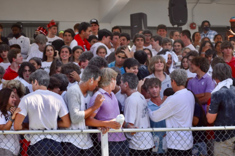 Students at the opening White Out game cover themselves in baby powder to celebrate a touchdown. Baby powder has been a Blue Zoo football tradition for years, until a recent administration ban now prohibits students from bringing the powder to games.