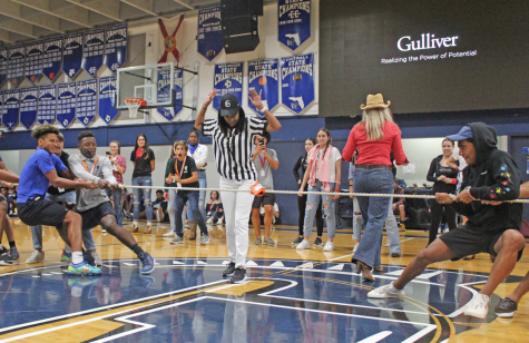 Assistant Principal Donna Lee referees a tug-of-war match during a pre-pandemic pep rally. A student-athlete in high school herself, Lee revels in school spirit.