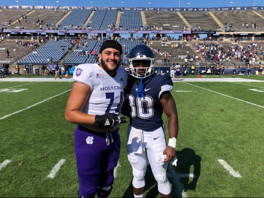 Alumni football players Eduardo Cachon and Robert Burns took a picture together after facing off on Sept. 4. Both Cachon and Burns also wrote for The Raider Voice during their time in high school.