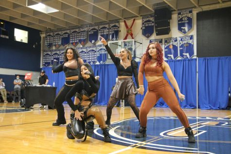The four members of Bella Dose performed in the gym on Oct. 6.